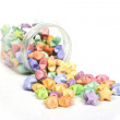 Stock Photo: Many multicolored origami happy stars in glass pot
