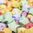 Many multicolored origami happy stars — Foto de Stock