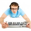 Man in blue shirt with midi keyboard and headphones lies isolate — Stok fotoğraf