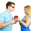 Young man in glasses and beauty blond girl holding red ball for  — Stock Photo