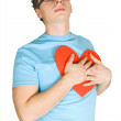 Stock Photo: Min blue shirt pressing to bosom red decor paper heart isolat