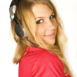 Young beauty blond girl in headphones smiling isolated on white, — Stock Photo