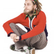 Young dreadlock man sit isolated — Stock Photo