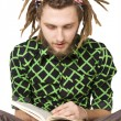 Stock Photo: Young dreadlock mreading book isolated