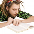 Young dreadlock man reading book isolated — Stock Photo