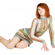 Beauty redhead woman in fashion dress sitting on floor and smili — Stock Photo