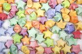 Molte stelle felice origami multicolori — Foto Stock