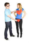 Young man in glasses press two paper hearts to blond girl, isola — Stock Photo