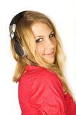 Unga skönheten blond flicka i hörlurar leende isolerad på vit, — ストック写真