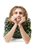 Young dreadlock man lie isolated — Stock Photo