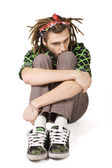 Young dreadlock man sit — Stock Photo