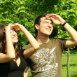 Young man and girl looking at sun — Stock Photo #13721350