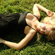 Stock Photo: Young beautiful blonde lying in open air