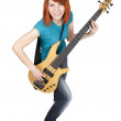 图库照片: Young beauty redhead girl playing bass guitar and smiling, full