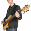 Young caucasian man with bass guitar, half body, looking at came — Stock Photo