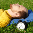 Man white breard in yellow shirt sleeping on summer meadow near — ストック写真