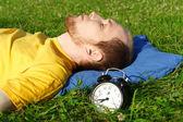 Man white breard in yellow shirt sleeping on summer meadow near — Stock Photo