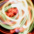 Abstract multicolored light background, spiral motion — Stock Photo #14511987
