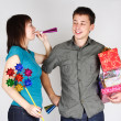 Young happy brunette man and girl holding many gifts and other p — Stock Photo
