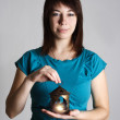 Young woman in blue shirt holding candlestick with burning candl — Foto Stock