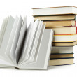 Stack of books in hard cover and one opened book in front, isola — Stock Photo