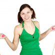 Stock Photo: Young girl in green shirt with skipping rope, smiling and lookin