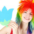 Young beauty woman in multicolored clown wig smiling and holding — Stock Photo #14768519