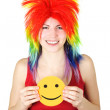 Royalty-Free Stock Photo: Young beauty woman in multicolored clown wig smiling and holding