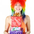 Young beauty woman in multicolored clown wig smiling and holding — Stock Photo