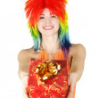 Young beauty woman in multicolored clown wig smiling and stretch - Stock Photo