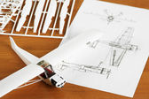 Kit for assembling white plastic airplane model with scheme — Stock Photo