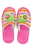 Pair of pink female house slippers with knitted decorative flowe — Stock Photo
