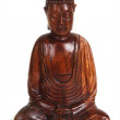 Wooden figurine of meditating Buddha isolated — Stock Photo