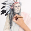 Man hand drawing pencil picture with american indian chieftain — Stock Photo