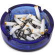 Cigarette ends in blue ashtray isolated — Stock Photo #14773975