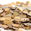 Many silver and golden coins isolated - Foto Stock