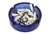 Cigarette ends in blue ashtray isolated — Stock Photo