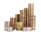 Pilhas de moedas de prata e ouro isoladas — Fotografia Stock
