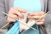 Woman knitting blue socks closeup — Foto Stock