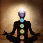 Yoga man in lotus pose with chakra symbols — Stock Photo