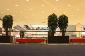 Rest zone with sofas and trees in mall — Stock Photo