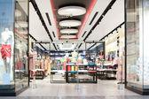 Entrance to fashion clothes store — Stock Photo