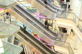 Mall with escalators and in motion — Stock Photo