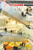 Mall with escalators and in motion — 图库照片