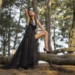 Sensual Fashion Model next to Tree — Stock Photo