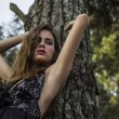 Sensual Young Model in Black Dress alone in Forest — Stock Photo #25073669