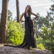 Cute Young Model in Black Dress alone in Forest — Stock Photo