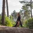 Attractive Women in Black Night Dress alone in Forest — Stock Photo