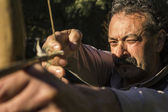 Archer with Antique Bow Aiming in Close up — Stock Photo