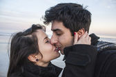 Young Couple Smiling and Kissing — Stock Photo